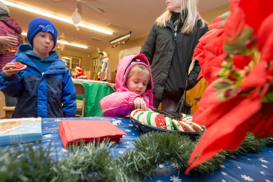 Ariana Lopa 4 right and her brother Jaden 6 makes a stop at the cookie table Saturday during Santa at Sloper hosted by the Mill Foundation at the YMCA