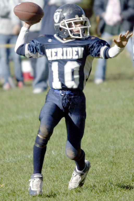 MERIDEN, Connecticut - Sunday, October 28, 2007 - Meriden Raiders quarterback Alexander Perez looks downfield to pass in a Pop Warner football game played against the Waterbury Knights on Sunday, Oct. 28 at Washington Park. Rob Beecher / Record-Journal