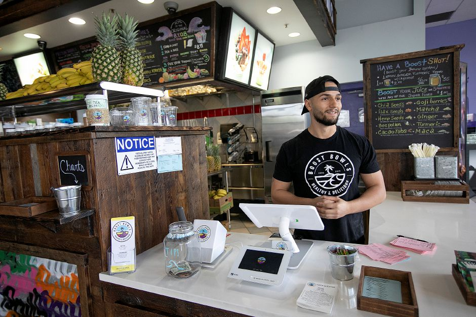 Kevin Ferreira, manager of Boost Bowls, talks about the new business in the lobby of Holiday Cinemas Stadium 14, 970 N. Colony Rd., Wed., May 15, 2019. Dave Zajac, Record-Journal