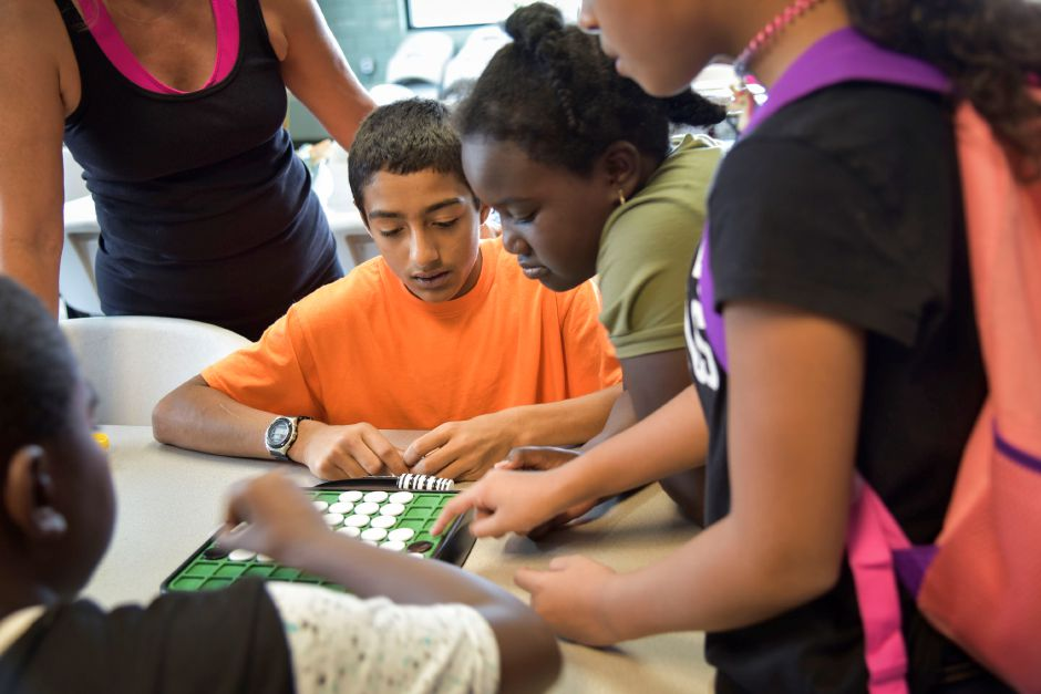 Xavier Arocho, 14, of Meriden plays Othello with friends at the Boys & Girls Club in Meriden on Wednesday, Sept. 19. | Bailey Wright, Record-Journal