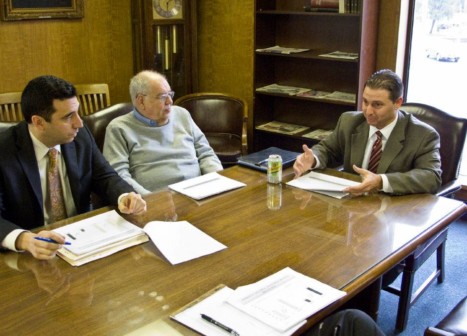 Mark Benigni, right, Superintendent of Meriden Schools, speaks to the Record-Journal editorial board about the upcoming school budget in Meriden, March 16, 2011. At left is Mike Grove, assistant superintendent, and Tom Bruenn, Board of Education member. (Christopher Zajac/Record-Journal)