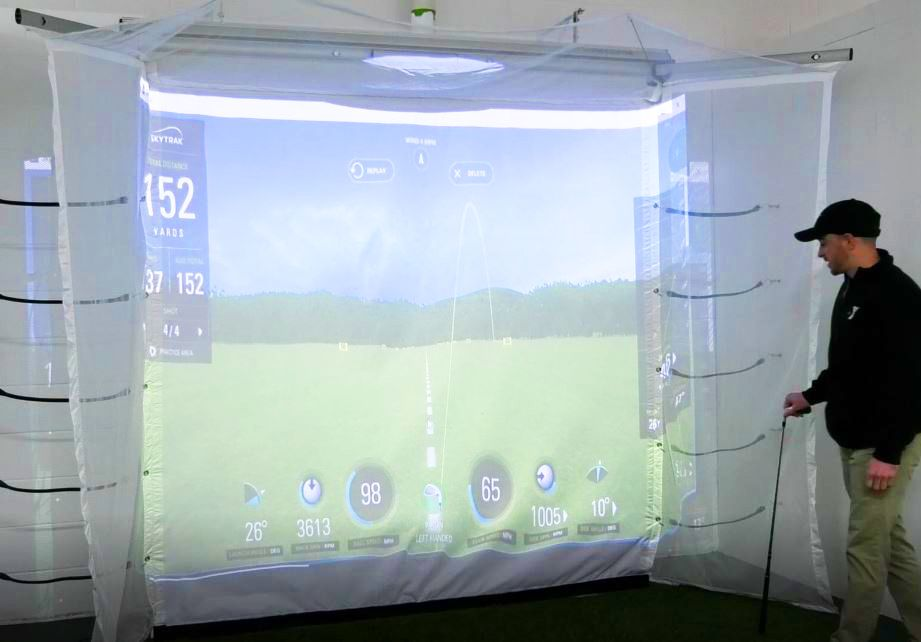 Sport Director Justin Ferreira demonstrates how the new golf simulator program tracks the ball at the Meriden YMCA, 110 W. Main St., Meriden. Friday, March 8, 2019. |Ashley Kus, Record-Journal