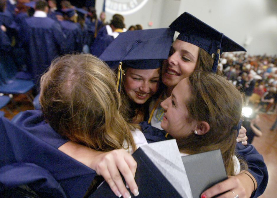 MERIDEN, Connecticut - Thursday, June 18, 2009 - Platt High School graduates embrace on stage following the Class of 2009 Commencement Excercises on Thursday at the school. Rob Beecher / Record-Journal