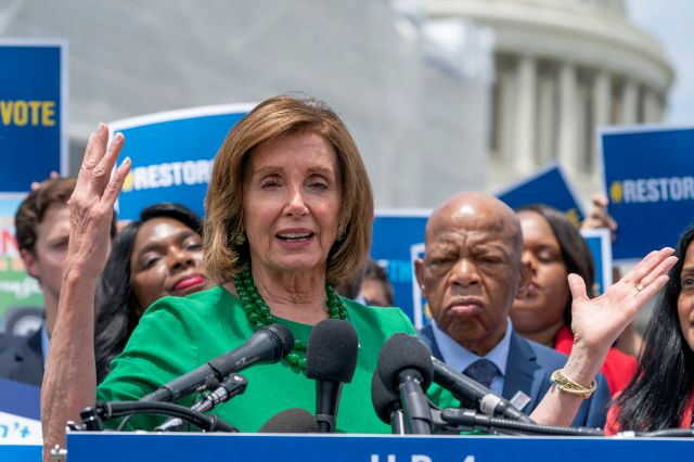 Speaker of the House Nancy Pelosi, D-Calif., flanked by Rep. Terri Sewell, D-Ala., left, and Rep. John Lewis, D-Ga., right, talks to reporters about the need for the Voting Rights Advancement Act of 2019, at the Capitol in Washington, Tuesday, June 25, 2019. (AP Photo/J. Scott Applewhite)