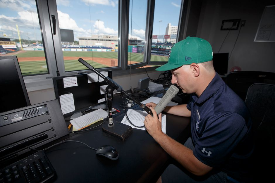 Jared Doyon of Meriden at work as the public address announcer for the Hartford Yard Goats Thursday at Dunkin' Donuts Park in Hartford. The Maloney grad worked 30-plus games this summer for the Yard Goats. | Justin Weekes / Special to the Record-Journal