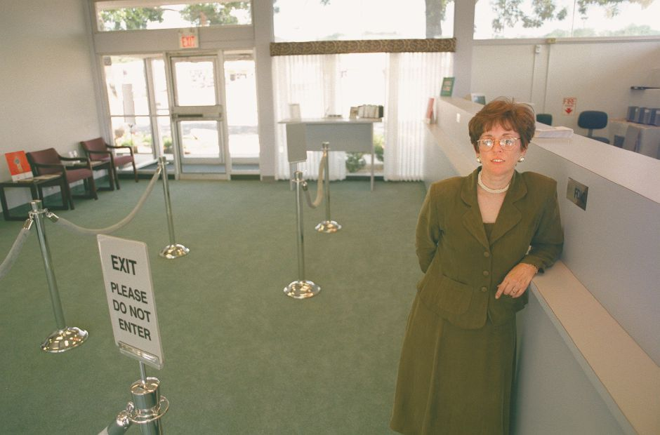 RJ file photo - Branch Manager Donna Lerardi gets ready to welcome customers to Southington Savings Bank