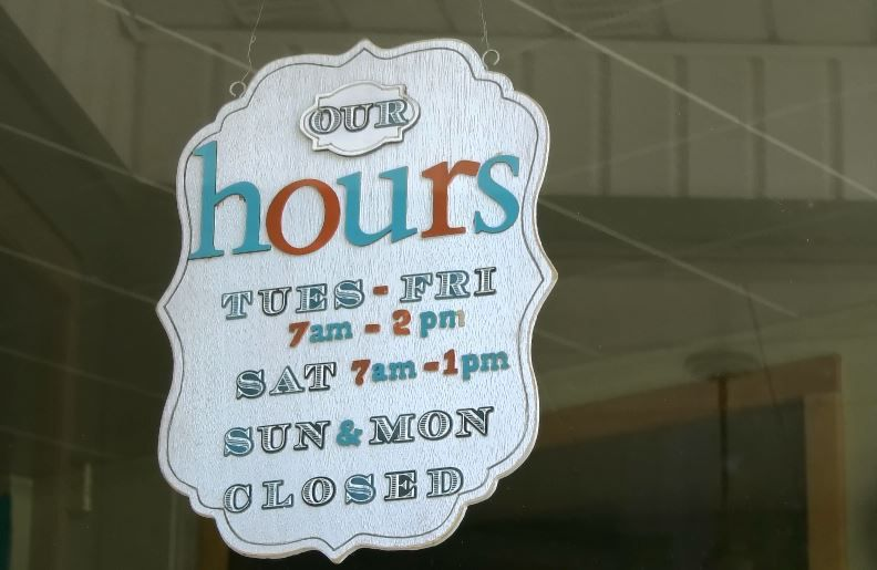 Hours displayed in the window of Sara J