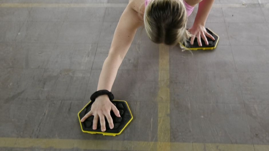 Kristen Dearborn demonstrates how to incorporate sliders into different workouts. Monday, April 8, 2019. |Ashley Kus, Record-Journal