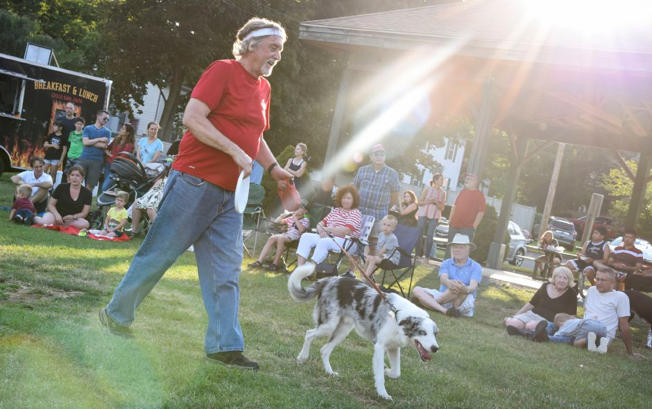 Salem resident Ed Jakubowski heads off the field with his dog Deacon Blue at a Skyhoundz competition on Thursday, August 1, 2019, at Doolittle Park in Wallingford. | Bailey Wright, Record-Journal