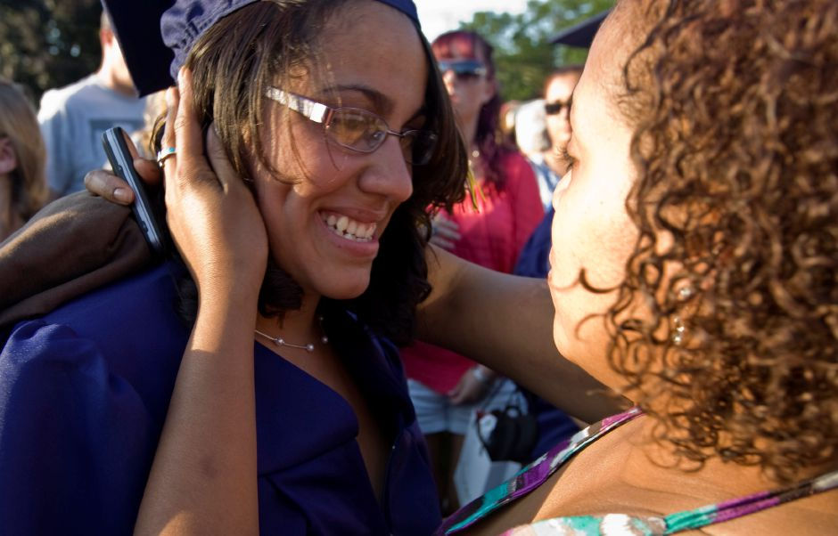 Carmen Mercado, left, is embraced by by her older sister Petra Rivera after graduating Platt High School Monday night in Meriden, June 20, 2011. (Christopher Zajac / Record-Journal)