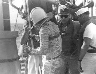 Robert Mullin, at right wearing sunglasses, was the senior medical officer on the Navy's USS Noa, and erformed a medical check-up on John Glenn after Glenn completed three orbits around the Earth in just under five hours, becoming the first American to ever orbit Earth.Mullin is a Wallingford native. | Contributed