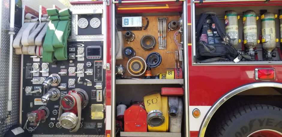 Firefighters opened all of the compartments on the firetruck to show the equipment used. The firetruck was featured at the 17th annual Touch-a-Truck event at the Southington Drive-In, at 995 Meriden-Waterbury Turnpike, on Saturday, May 18, 2019. Photos by Jeniece Roman, Record-Journal