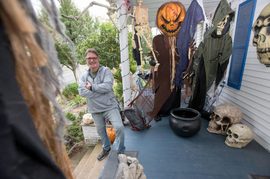 Vince Proto oif Wallingford has begun to set out his extensive Halloween display at his home Tuesday on North Main Street in Wallingford October 24, 2017 | Justin Weekes / For the Record-Journal