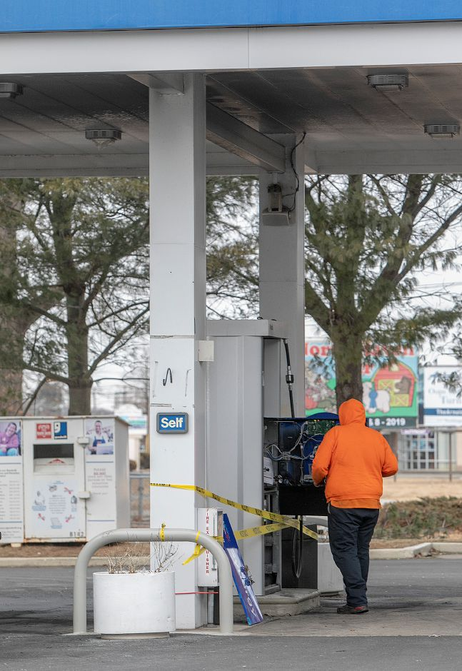 Israel DeJesus, working for Hartford based Alliance, inspects a gas pump after a postal vehicle caught fire at the Mobil Station at 276 Washington Ave., in North Haven, Wed., Feb. 27, 2019. Dave Zajac, Record-Journal