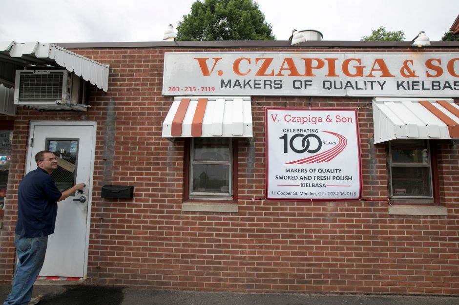 Walter Paluszewski, co-owner of V. Czapiga & Son in Meriden, closes up for the day, Friday, June 22, 2018. The business is celebrating 100 years. Dave Zajac, Record-Journal