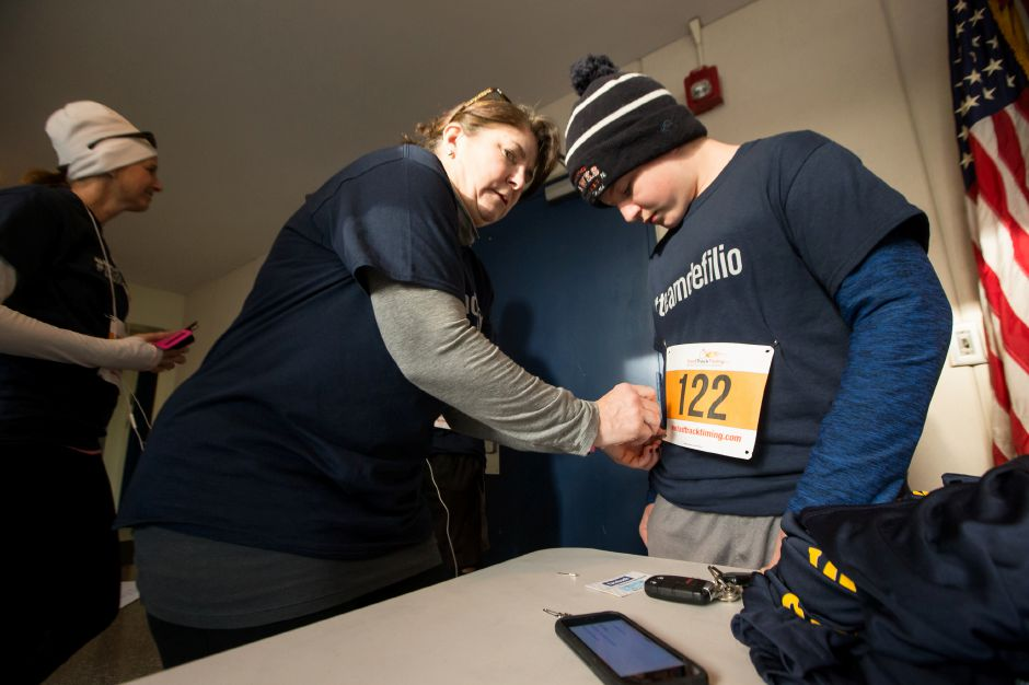 kathy Pettit of Wallingford helps her son Daniel 14 with his bib number Sunday during the Kiwanis Turkey Trot 5k and 5 mile at Stevens School in Wallingford November 18, 2018 | Justin Weekes / Special to the Record-Journal