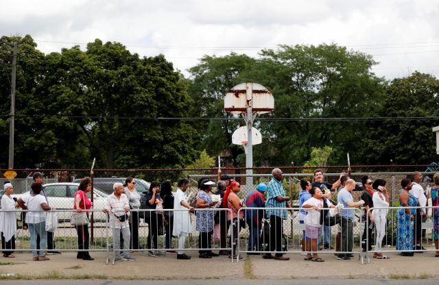 People stand in a line stretching for blocks outside New Bethel Baptist Church to pay their respects to legendary singer Aretha Franklin Thursday, Aug. 30, 2018, in Detroit. Franklin died Aug. 16, 2018 of pancreatic cancer at the age of 76. (AP Photo/Jeff Roberson)