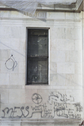 Exterior of  Curtis Memorial which is undergoing renovation.  Graffiti blemises part of the building which faces Pleasant St. Photographed on Monday, April 9, 2001.