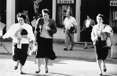 Residents of Osijek run to a shelter at the main square on Tuesday, Sept. 10, 1991 after the federal Yugoslav Army fired artillery shells at the center of the town.   A woman was killed during the shelling of the square. The first curfew in Croatia since World War II at night, did little to curb ethnic fighting between Serbs and Croats. (AP Photo/Gepa)