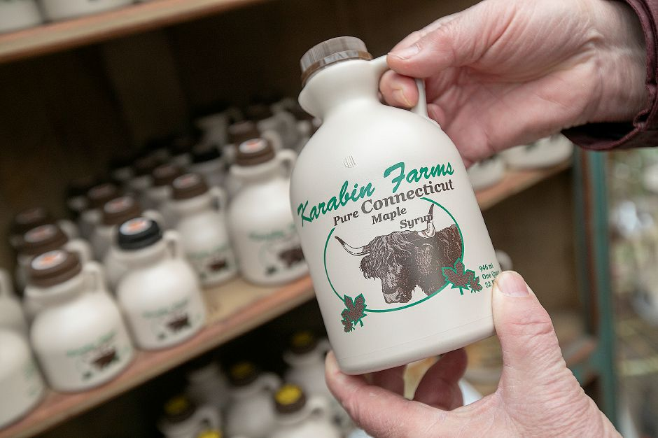 Michael Karabin of Karabin Farms holds maple syrup made in his sugarhouse at the Southington farm at 894 Andrews St., Tues., Mar. 19, 2019. Dave Zajac, Record-Journal