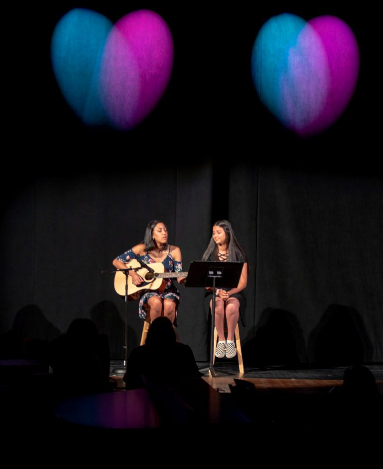 Eliana Tolentino, 17, left, and Elaine Tolentino, 14, rehearse at Sheehan High School July 10, 2019. The Junior Performance Academy is holding a benefit concert for Master