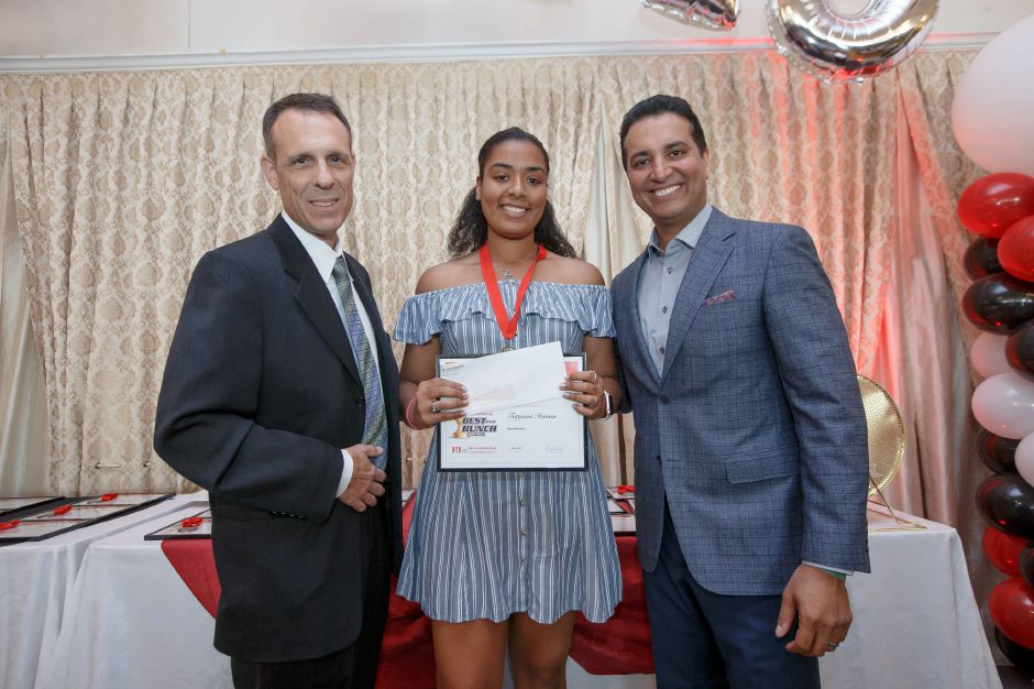Female Scholar Athlete of the Year Tatyana Inman with Bryant Carpenter and Kevin Negandhi Sunday during the third annual Record-Journal Best of the Bunch Brunch Awards at the Aqua Turf Club in Plantsville June 24, 2018 | Justin Weekes / Special to the Record-Journal