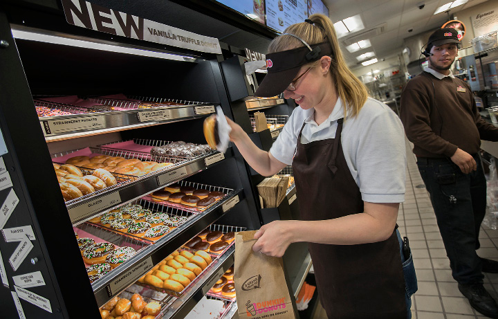 Katie Gontarski, crew member, fills a donut order next to Emiliano Badillo, shift leader, at the new Dunkin Donuts at 1699 Highland Ave. in Cheshire, Friday, March 24, 2017. | Dave Zajac, Record-Journal