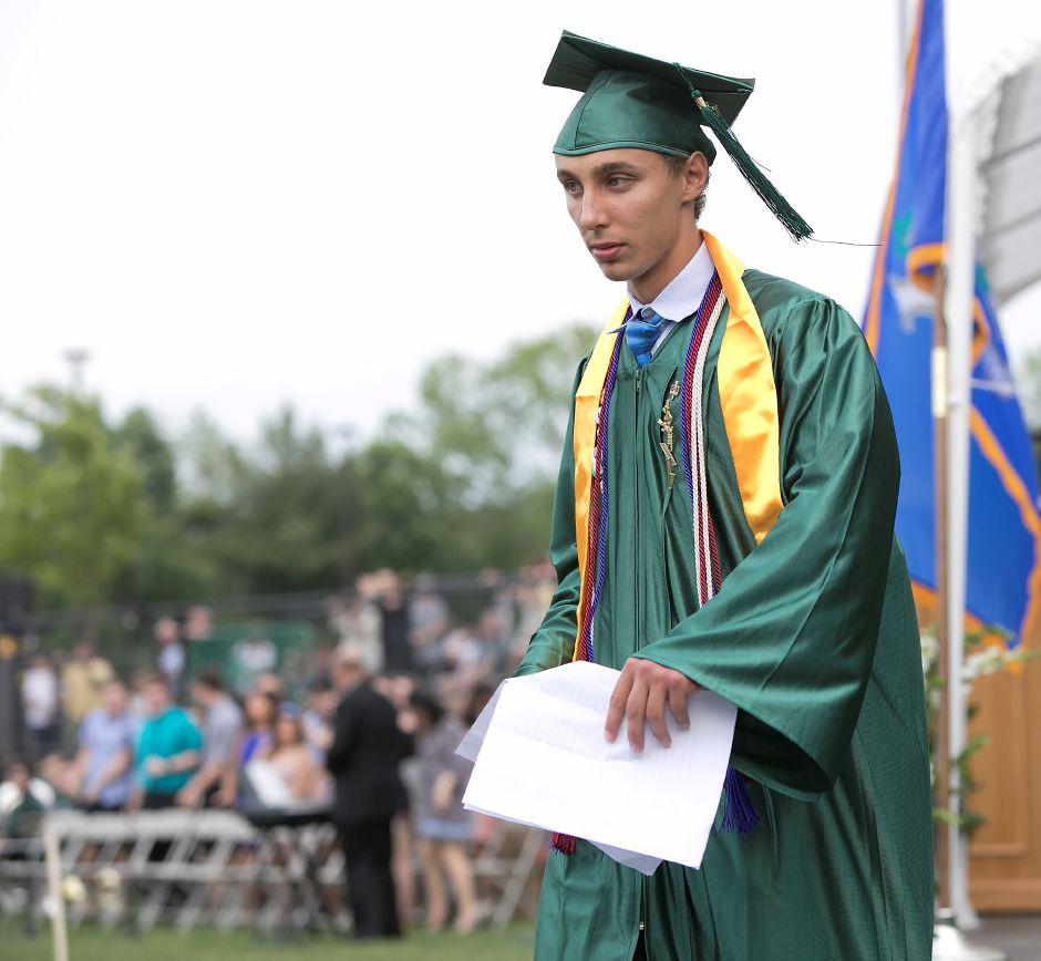 Valedictorian Jonathan Goodman walks off the stage after his speech during graduation ceremonies at Maloney High School in Meriden, Tuesday, June 13, 2017. | Dave Zajac, Record-Journal