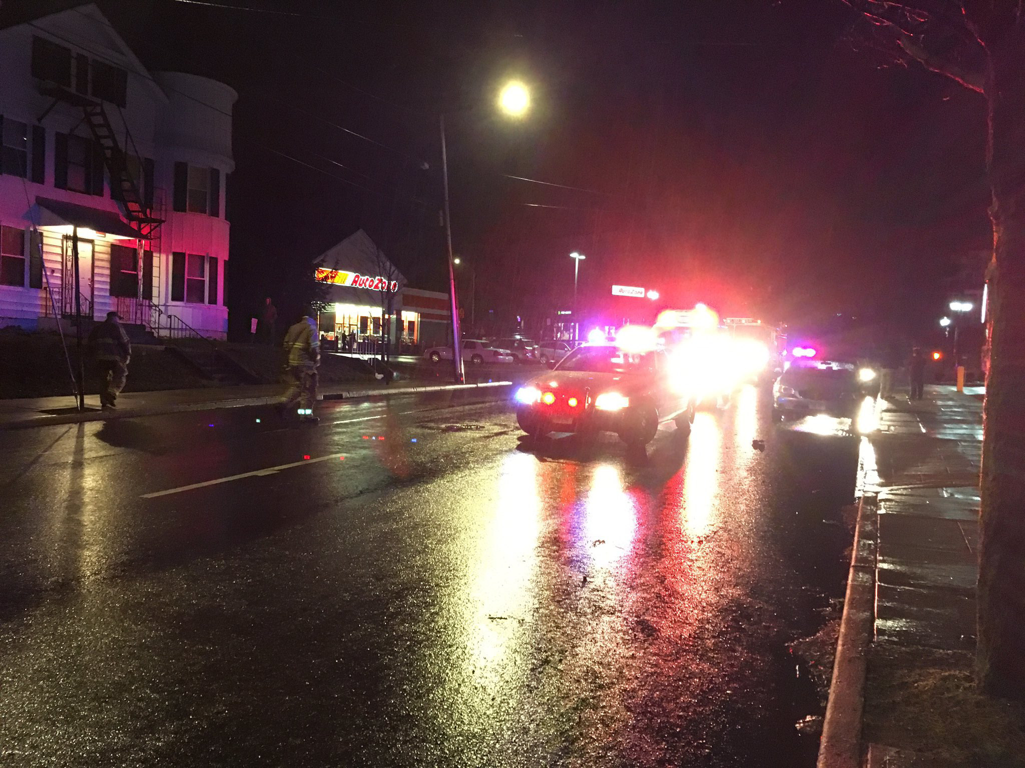 Emergency crews respond to a report of a pedestrian struck on Cook Avenue the evening of Thursday, Dec. 29, 2016. | Lauren Takores, Record-Journal