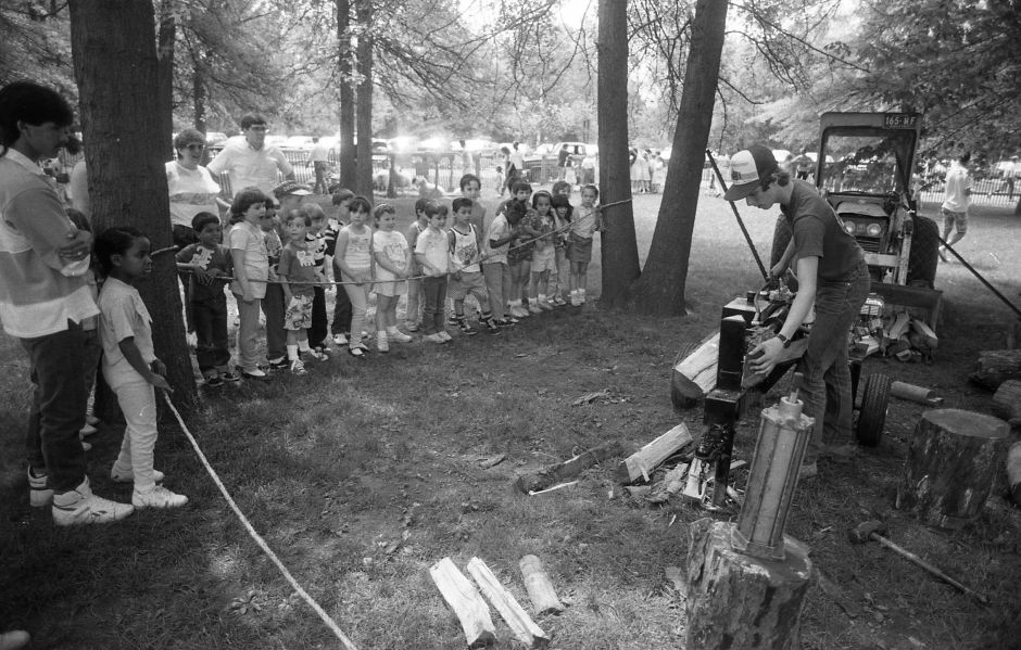 RJ file photo - Jim McCue, 17, demonstrates a hydraulic log splitter for elementary school students visiting Lyman Hall High School May 23, 1989.