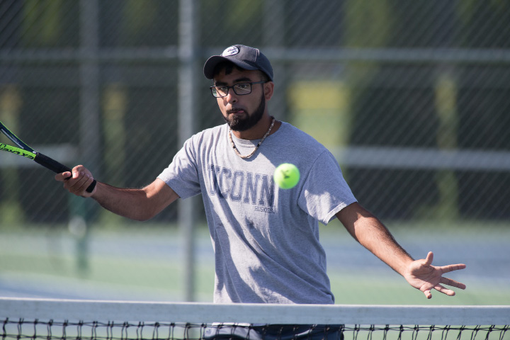 Kunal Kataria of Southington plays a volley at the net in the A doubles final Sunday during the Wayton Open Tennis finals at Southington High School in Southington Jul. 16, 2017 | Justin Weekes / For the Record-Journal