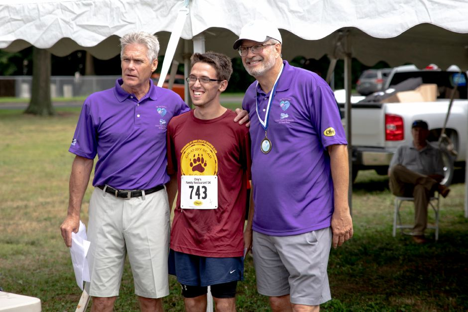 William Petit, right, poses with first place runner Dean Yost in the Chip's Family Restaurant 5k Road Race. The Petit Family Foundation holds the race every year to raise money for the foundation