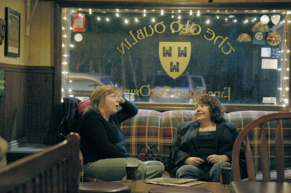 WALLINGFORD, Connecticut - Thursday, March 13, 2008 - From left, Carrie Clark of Guilford and Trina James of Wallingford talk on a couch in the Old Dublin Bar on Quinnipiac St. in Wallingford before Thursdays traditional Irish music sessions. Rob Beecher / Record-Journal