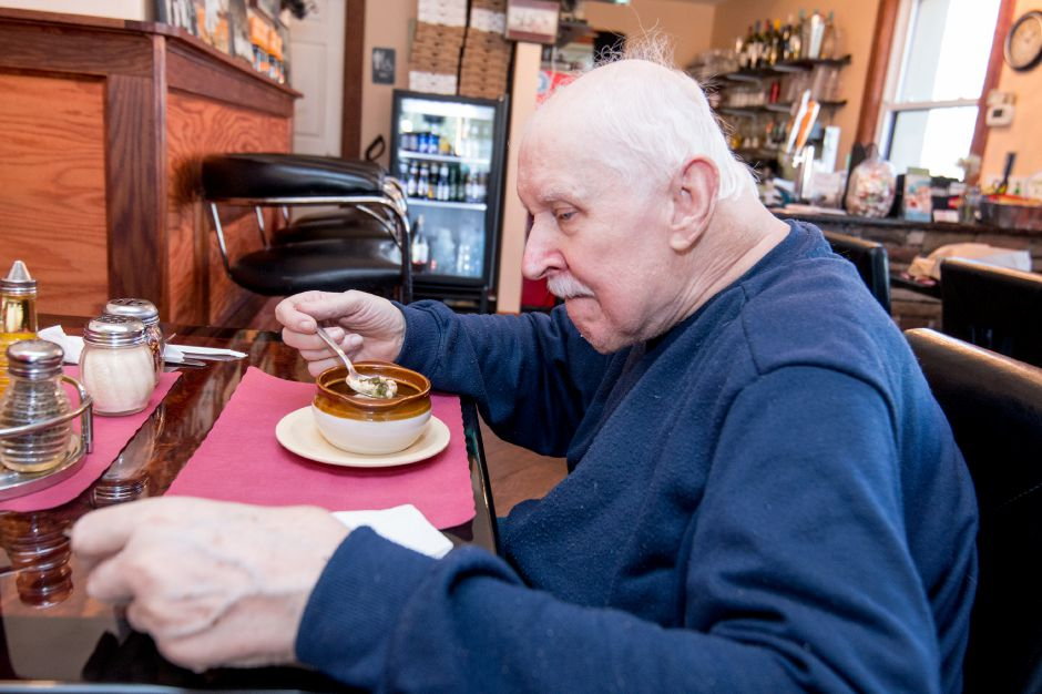 Walter Zarzycki, of Plainville, enjoys a chicken noodle soup at Max Pizza 6 in Southington. The restaurant held its grand opening Thursday, April 20, 2018. | Devin Leith-Yessian/Record-Journal