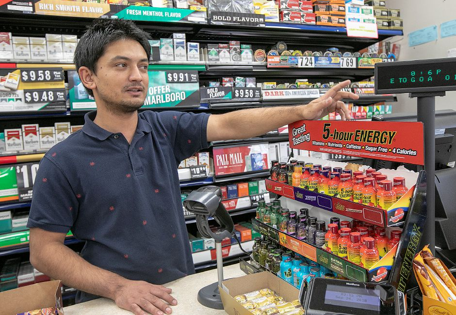 Srijan Katwal, manager of Global Food Mart and gas station at 570 Center St., talks about how his business has been affected by the bridge construction site in Wallingford.