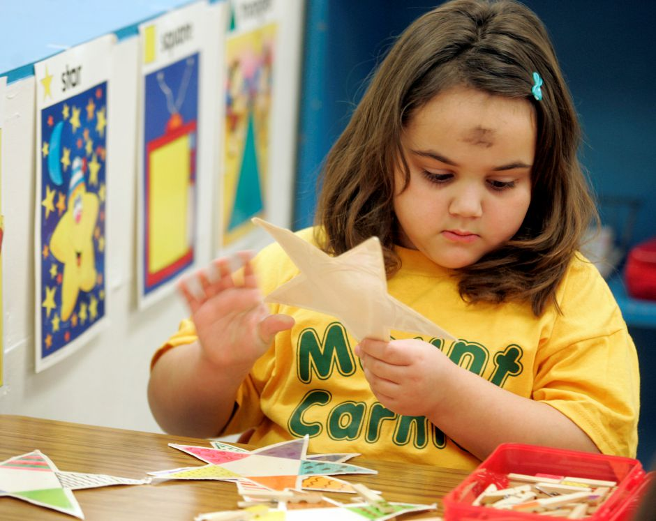 Savannah Murphy, 6, of Meriden holds a star while playing a space and creation game in her kindergarten class at Our Lady of Mount Carmel school in Meriden February 6, 2008. Murphy and classmates received ashes from Father David Carey earlier in the day in observance of Ash Wednesday. (dave zajac photo)