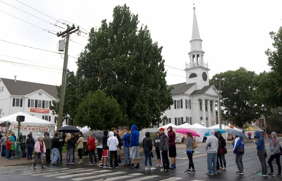 A long line for apple fritters stretches across Main Street on a drizzly opening night at the 48th Annual Apple Harvest Festival in Southington, Friday, September 30, 2016. The festival runs September 30, October 1-2 & October 7-9. | Dave Zajac, Record-Journal