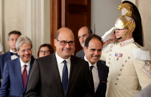 Democratic Party leader Nicola Zingaretti, center, leaves after meeting Italian President Sergio Mattarella, in Rome, Thursday, Aug. 22, 2019. President Sergio Mattarella continued receiving political leaders Thursday, to explore if a solid majority with staying power exists in Parliament for a new government that could win the required confidence vote. (AP Photo/Alessandra Tarantino)