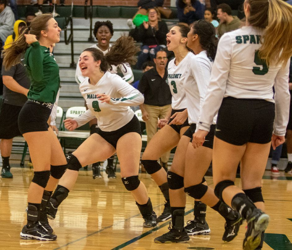 The Maloney volleyball team improved to 8-10 and clinched a state tournament berth with Monday's 3-1 victory ini Berlin. | Aaron Flaum, Record-Journal