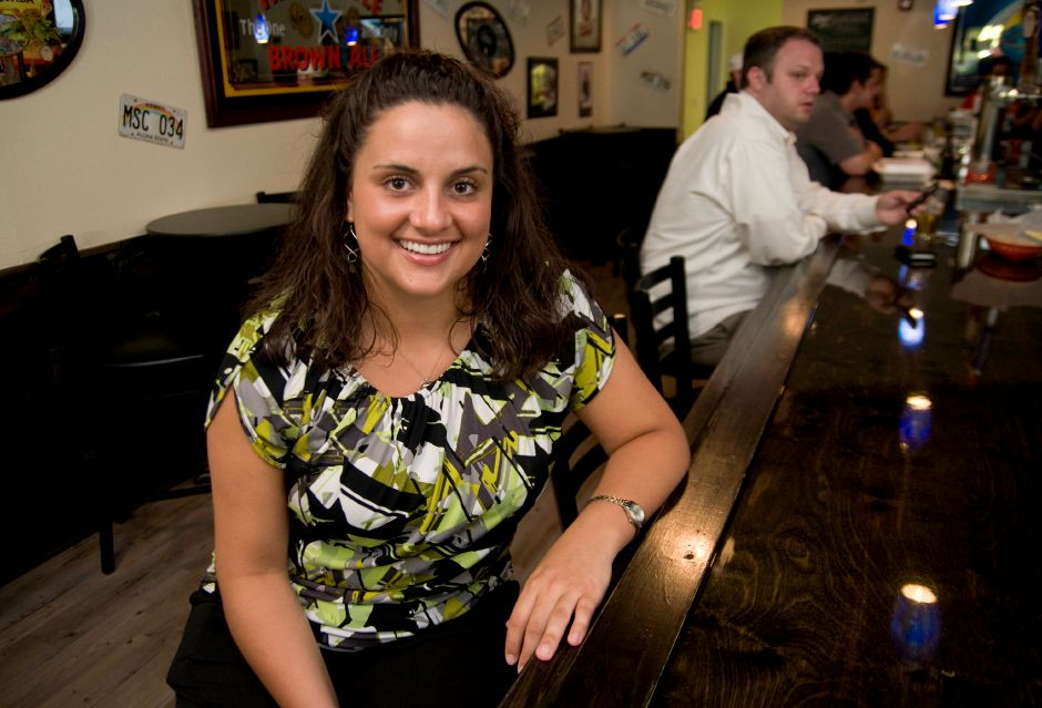 Hayley Brown, General Manager of Route 10 Tavern in Southington, sits for a portrait at the restaurant