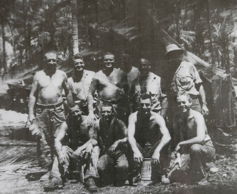 Photo of WWII U.S. Navy veteran Ralph Rowland, bottom right, with part of his platoon in New Guinea in 1944. Rowland, one of the oldest members of the town's VFW post, was honored by the Town Council earlier this year. Courtesy Ralph Rowland