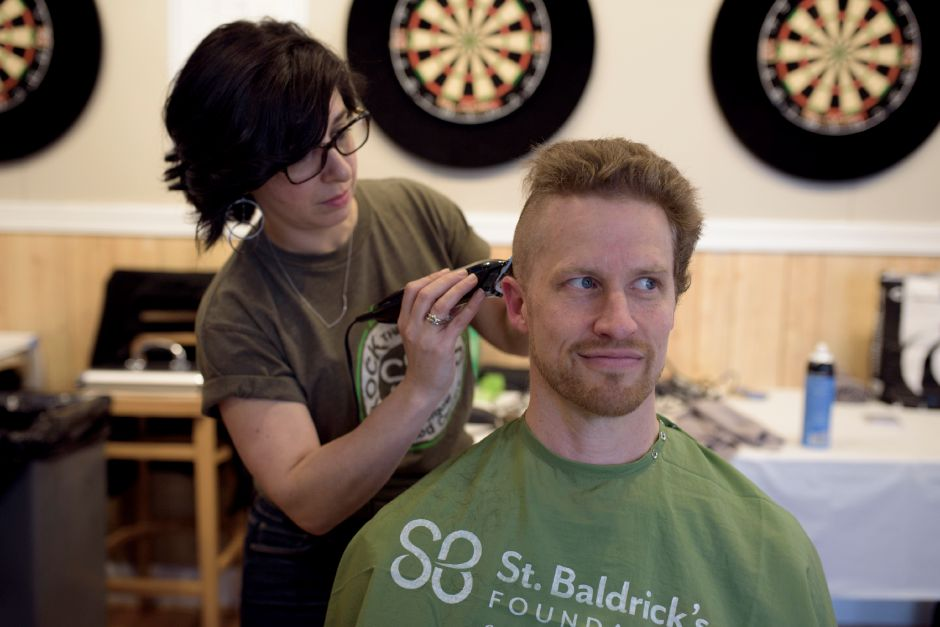 Andy Hooper of Wallingford shaves his head for the 8th year during the St. Baldrick