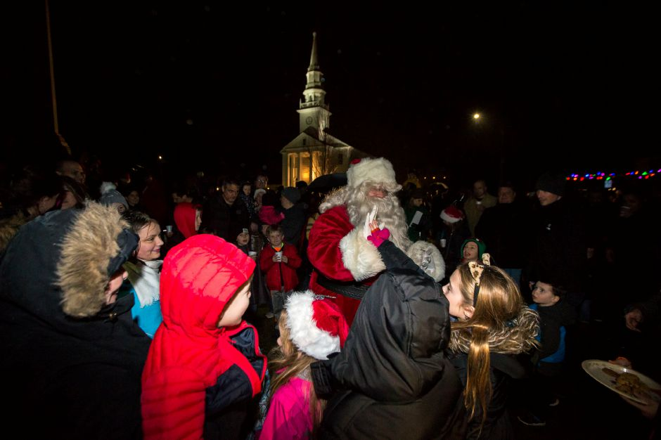 Santa gets welcomed by kids Sunday during the annual tree lighting at the First Congregational Church in Cheshire December 2, 2018 | Justin Weekes / Special to the Record-Journal