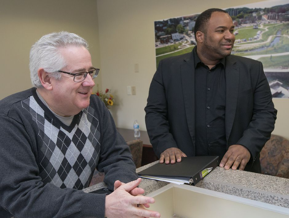 Business recruitment specialist Dave Cooley, left, smiles with prospective client and Meriden native, Richard Pennyman, at the new Making Meriden business center at 5 Colony St., Monday, March 5, 2018. Dave Zajac, Record-Journal