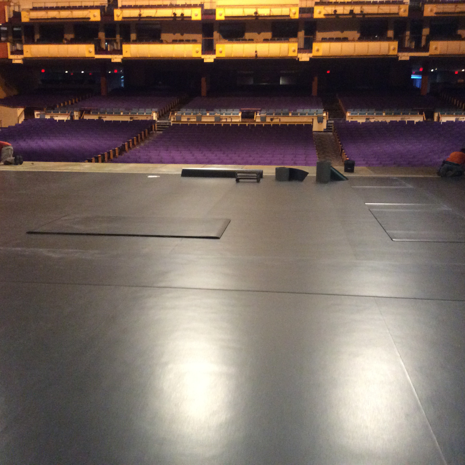 Crews installing the new floor at the Oakdale Theatre. | Courtesy of Peter Escobar