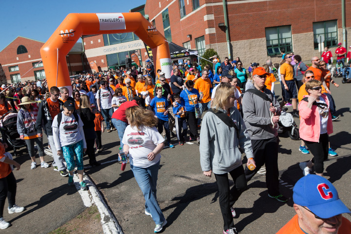 Participants at Walk MS get moving last April at Cheshire High School. This year's event will be held on Sunday.  | File photo, Record-Journal