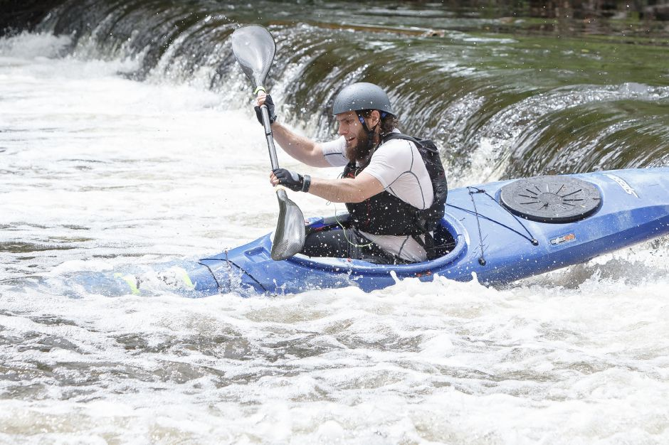 Adam Beyer of Ellington navigates the water pipe fall Sunday during the 38th annual Down River Classic on the Quinnipiac River in Meriden May 20, 2018 | Justin Weekes / Special to the Record-Journal