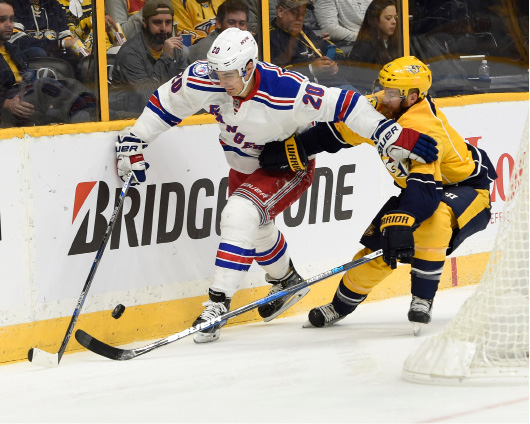 New York Rangers left wing Chris Kreider (20) fends off Nashville Predators defenseman Ryan Ellis (4) during the first period of an NHL hockey game Saturday, Dec. 17, 2016, in Nashville, Tenn. (AP Photo/Sanford Myers)