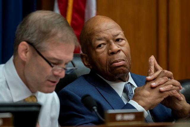 House Oversight and Reform Committee Chairman Elijah E. Cummings, D-Md., listens to an objection by Rep. Jim Jordan, R-Ohio, left, the ranking member, as they debate whether to hold Attorney General William Barr and Commerce Secretary Wilbur Ross in contempt for failing to turn over subpoenaed documents related to the Trump administration