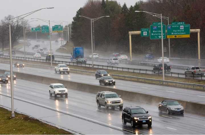 FILE PHOTO -- Motorists travel on the Wilbur Cross Pkwy and I- 91 in Meriden, Monday, March 14, 2016. Tolls have been proposed for the area to fund road projects over the next 30 years.|  Dave Zajac / Record-Journal